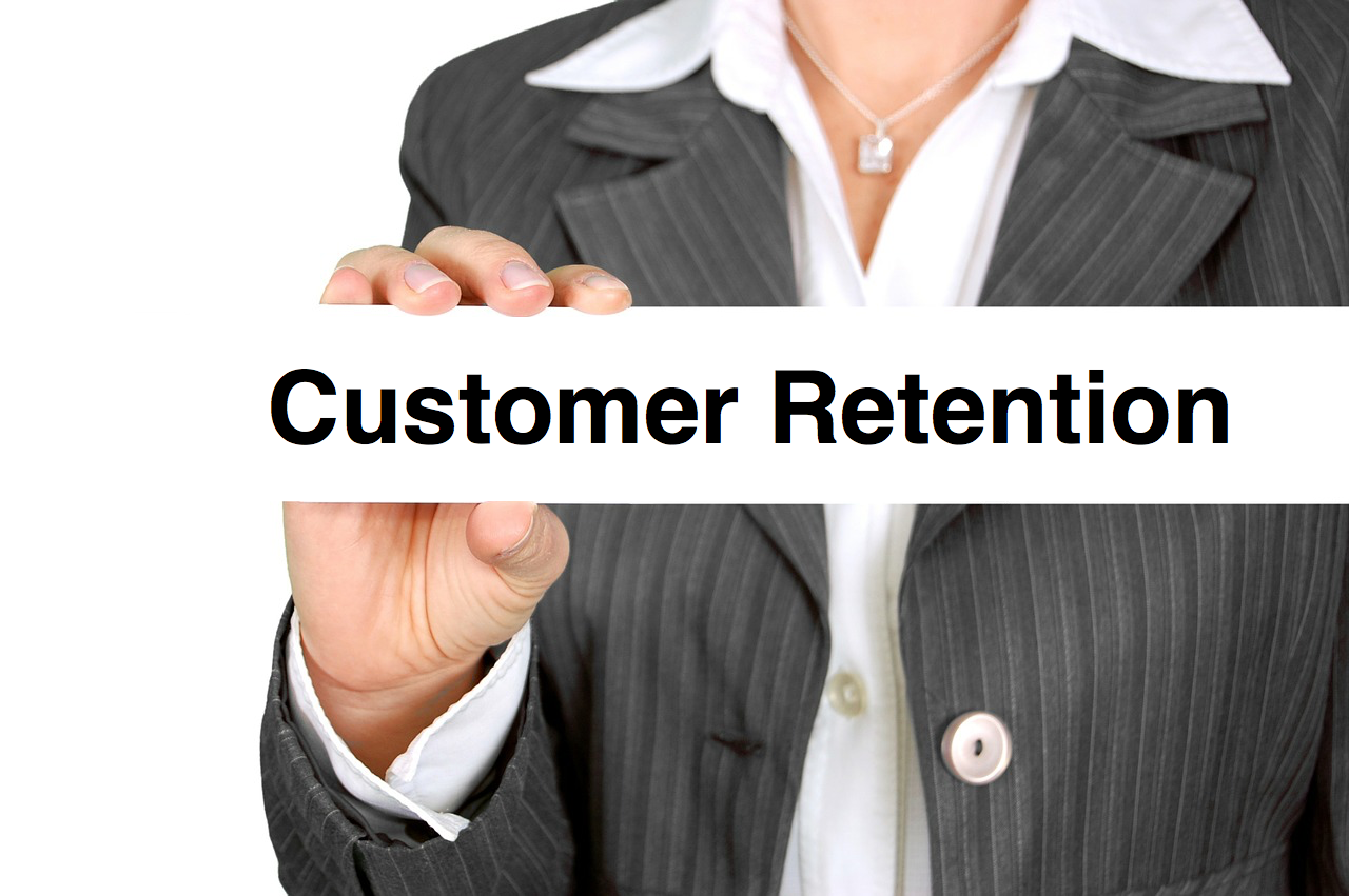 Employee holding a Customer Retention card
